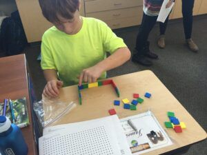 student using manipulatives